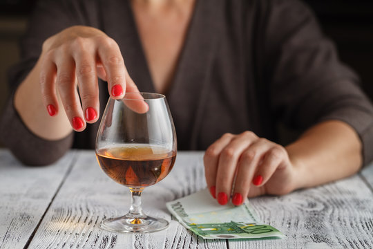 women with alcohol close up