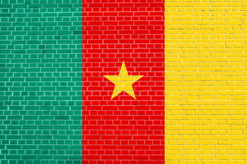 Flag of Cameroon on brick wall texture background