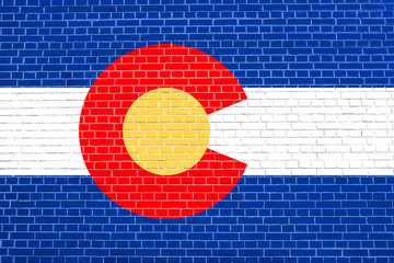 Flag of Colorado on brick wall texture background