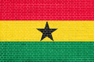 Flag of Ghana on brick wall texture background