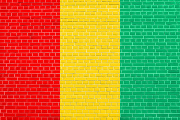 Flag of Guinea on brick wall texture background