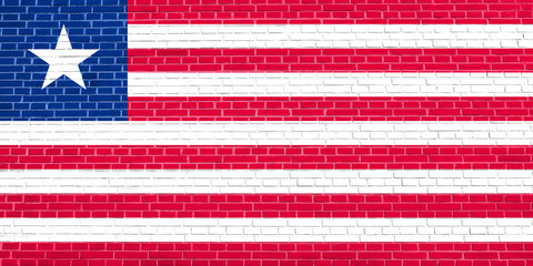 Flag of Liberia on brick wall texture background