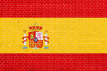 Flag of Spain on brick wall texture background