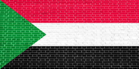 Flag of Sudan on brick wall texture background