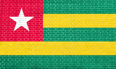 Flag of Togo on brick wall texture background