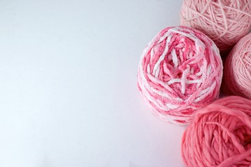 Balls of wool cotton silk yarn set on copy space white background on left
