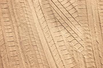 Tire tracks on the sand, sand texture