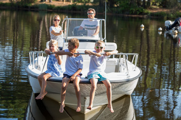family enjoying a summer day on a boat
