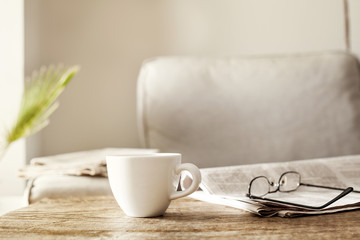 Newspapers with eyeglasses and coffee