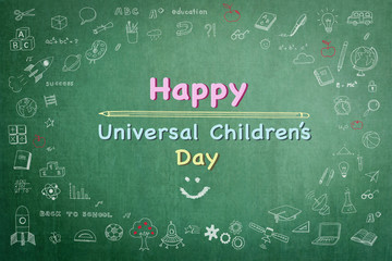 Happy universal children's day text message announcement greeting with smiley face and freehand doodle chalk sketchy drawing on grunge green chalkboard background: World children day celebration