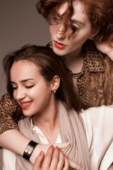 Two girls in safari style sensually posing in the studio