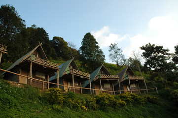Lovely pairs of wooden cottages in Northern Thailand