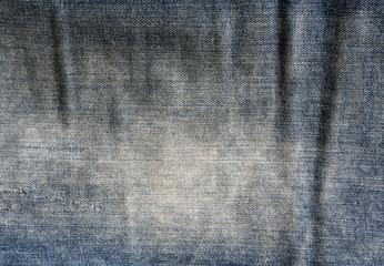 Blue worn jeans texture.
