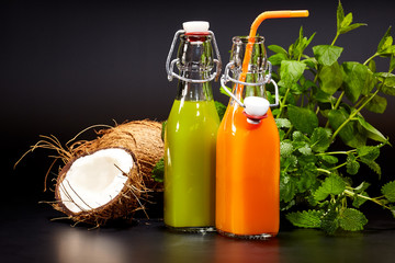 Glasses with fresh organic vegetable and fruit juices isolated