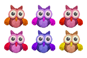 A set of colorful cartoon clay owls.