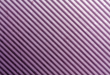 Purple metal plate surface with scratches.