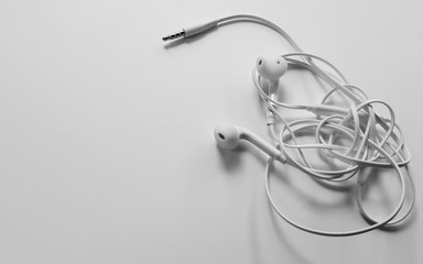 Tangled headphone cable on white background isolated.