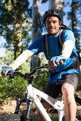 Portrait of male mountain biker with bike