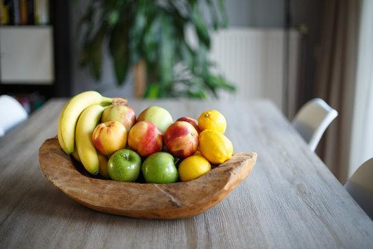 Wooden fruit basket on table