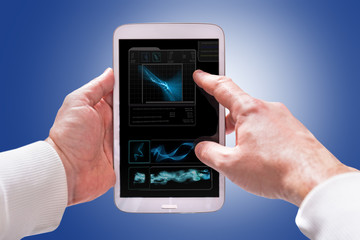 Touchscreen tablet computer in hands with technology screen