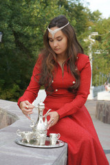 young eastern appearance woman in the summer park