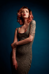 Portrait of a beautiful young girl with tattoo in the Studio