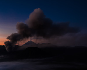 Smoke and ash from the volcano hovering over the water (Bohorok, Indonesia)