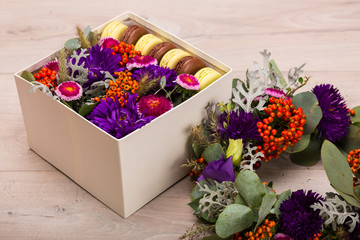Seasonal autumn wreath and a hat box with flowers