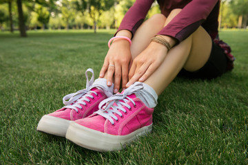 Young woman wearing pink sneakers