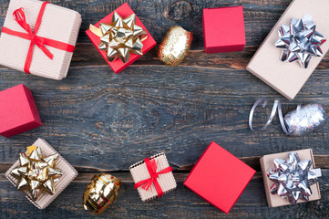 Gift presents on old wooden background. Christmas background with gift boxes and ribbons. Top view
