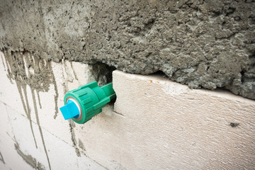 Potable water pipe embedded in the block wall., Construction sit