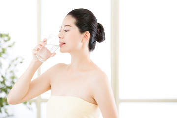 beautiful asian women drinking natural clean water after shower