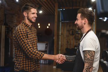 handshake of two guys at barbershop