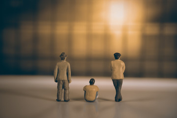 Toy people / View of miniature toy peoples watch sunset. Vintage style.