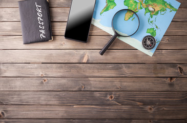 Preparation for Traveling concept, passport, smartphone, map on a wooden background. with copy space.