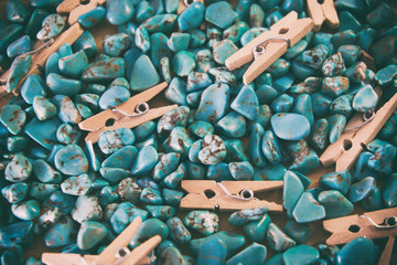 blue background, gemstone turquoise on a wooden background with