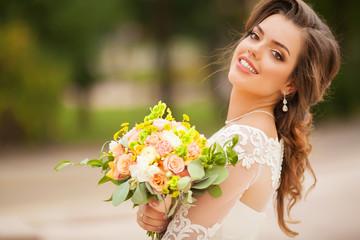 Beautiful original wedding bouquet in the bride hands