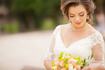 Portrait of Young Beautiful Attractive Bride with Flowers. White Dress and Wedding Decorations.