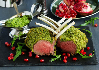 Rack of lamb in herb cheese and breadcrumbs. A festive meal. Selective focus.