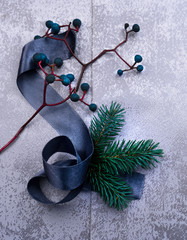 christmas, new year. silver plate, silk, fur-tree branch, a bunch of grapes. top view