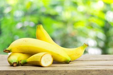 Banana, Bunch of organic ripe yellow banana on wood table with g