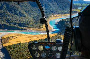 View from helicopter on beautiful landscape of mountain river. Whataroa, South Island, New Zealand. Selective focus on landscape