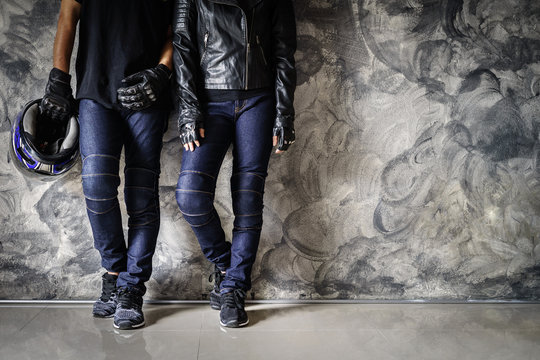 Biker man wearing jeans and leather jecket