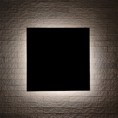 Black sign and Lighting design on modern brick wall.