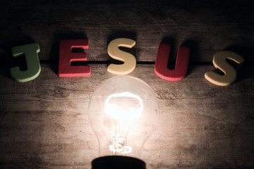 bulb and colorfull word written jesus