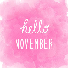 Hello November greeting on abstract pink watercolor background