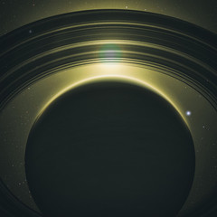 Fototapete - planet saturn with rings at sunrise on the space background