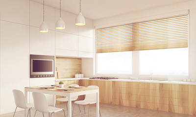 Corner view of sunlit kitchen table and TV set