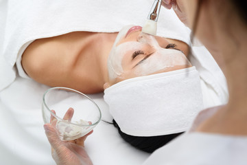 Sensual girl enjoying healthy mask at spa