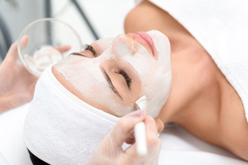 Relaxed young woman enjoying spa procedure